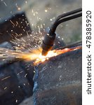 Small photo of metal cutting with acetylene torch