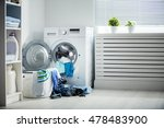Stock photo laundry a washing machine and a pile of dirty clothes at home 478483900