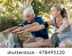mature couple stretching at... | Shutterstock . vector #478495120