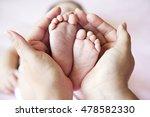mother hands holding baby feet | Shutterstock . vector #478582330