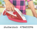 ironing clothes on an ironing... | Shutterstock . vector #478603396