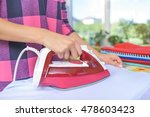 the woman to iron the clothes... | Shutterstock . vector #478603423