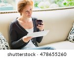 woman sitting on a couch with a ... | Shutterstock . vector #478655260