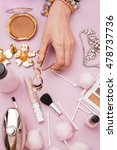 female hand holding make up tool | Shutterstock . vector #478737736