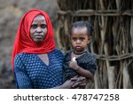 Small photo of ETHIOPIA, - NOVEMBER, 2016. PORTRAIT OF A WOMAN WITH A CHILD FROM THE ETHNIC GROUP AMHARA
