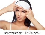 young woman squeezing her... | Shutterstock . vector #478802260