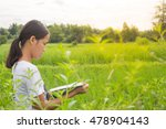 women reading a book on nature. | Shutterstock . vector #478904143