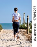 young woman jogging on the beach | Shutterstock . vector #47898079