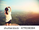 young asian woman taking photo... | Shutterstock . vector #479038384