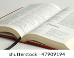 An Opened Bible Focused On The...