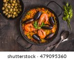 paella in black pan with rice ... | Shutterstock . vector #479095360