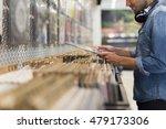 man browsing vinyl album in a... | Shutterstock . vector #479173306