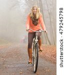 happy active woman riding bike... | Shutterstock . vector #479245798
