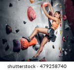 athletic female climbing on a... | Shutterstock . vector #479258740