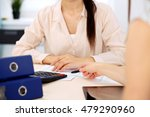two female accountants counting ...   Shutterstock . vector #479290960