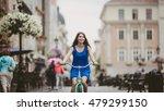 Joyful Girl Is Riding A Bike O...