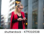 Business Woman Texting On Cell...
