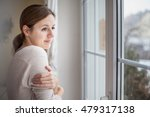 woman looking from a window of... | Shutterstock . vector #479317138