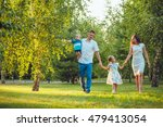 happy young family of four... | Shutterstock . vector #479413054