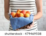 Woman Holding Heap Of Apricots...