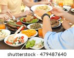 friends passing plate with... | Shutterstock . vector #479487640