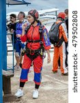 Small photo of Seville, Spain - May 7, 2016: Beautiful woman prepares to skydive. Skydiving center at La Juliana Aerodrome offer world-class coaches for progression courses or team training of any discipline.