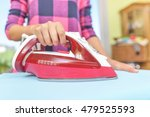 ironing clothes on an ironing... | Shutterstock . vector #479525593