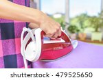 the woman to iron the clothes... | Shutterstock . vector #479525650