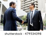 two businessmen shaking their... | Shutterstock . vector #479534398