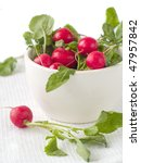 Garden radish in a bowl. A photo on a white towel - stock photo