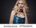 blonde hair woman on dark... | Shutterstock . vector #479630044