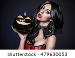 Small photo of Female vampire and black pumpkin