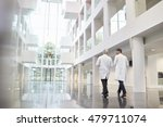 rear view of doctors talking as ... | Shutterstock . vector #479711074