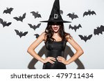Happy gothic young woman in...