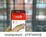 Small photo of MONTREAL, CANADA - August 8, 2016 - Yelp mobile app on screen of Samsung S7 in hand. Yelp is a crowd-sourced local business review and social networking site and company.
