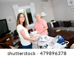 cheerful young girl ironing and ... | Shutterstock . vector #479896378