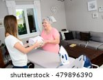 Cheerful Young Girl Ironing An...