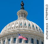 Stock photo dome of the us capitol at washington dc with a united states flag 479899813