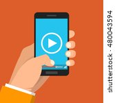 smartphone with video player on ... | Shutterstock .eps vector #480043594