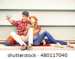Young Couple Taking Selfie...