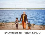 dad with the son fishing on the ... | Shutterstock . vector #480452470
