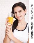 Woman Drinking Orange Juice...