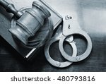 Gavel And Handcuffs With Legal...