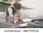 little asian child tying his... | Shutterstock . vector #480799318