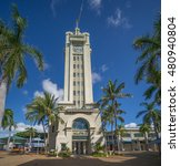 Small photo of Honolulu, Hawaii, USA, Sept. 10, 2016: Morning profile of the Aloha Tower, gateway to Honolulu Harbor, surrounded by palm trees.