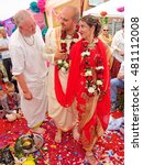 Small photo of BUSHEY, JUNE 19: Hindu wedding in the Vedic tradition, England, UK 2016. The priest wishes all the best to a bride and a bridegroom.