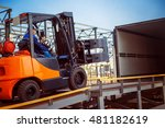 Forklift Is Putting Cargo From...