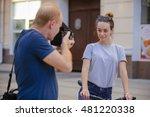 Photographer Shoots A Model...