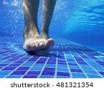 Underwater Shot Of Feet Walkin...