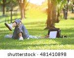 relaxing in green grass in the... | Shutterstock . vector #481410898
